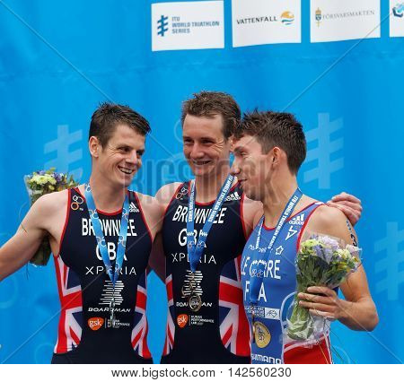 STOCKHOLM - JUL 02 2016: The smiling triathlete medalist Alistair and Jonathan Brownlee and Pierre Le Corre on the podium in the Men's ITU World Triathlon series event July 02 2016 in Stockholm Sweden