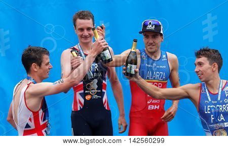 STOCKHOLM - JUL 02 2016: The medalist triathletes Alistair and Jonathan Brownlee Pierre Le Corre and Fernando Alarza drinking champagne on the podium in the Men's ITU World Triathlon series event July 02 2016 in Stockholm Sweden