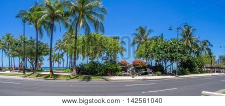 HONOLULU, USA - AUG 8: Kalakaua Avenue along Waikiki beach on August 8, 2016 in Honolulu, Usa. Waikiki beach is neighborhood of Honolulu, best known for white sand and surfing.