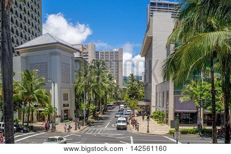 HONOLULU, USA - AUG 8: Kalakaua Avenue along Waikiki beach on August 8, 2016 in Honolulu, Usa. Waikiki beach is neighborhood of Honolulu, best known for white sand and surfing.