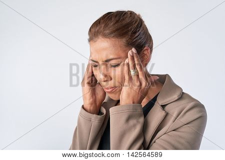 Woman massaging her temples, easing her headache pain tension migraine