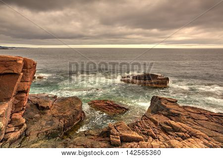 View of the rocky cliff shore line at Acadia National Park. Maine New England USA - HDR Image
