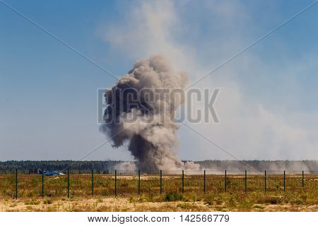 An explosion after a bombing at a military airfield.