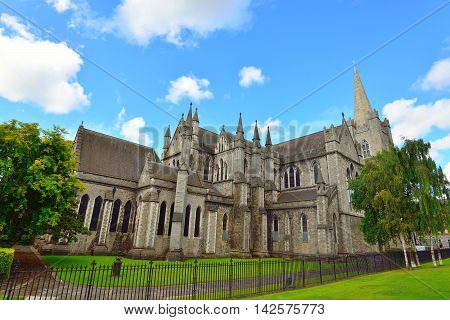 St Patrick's Cathedral Dublin during summer. Green grass and blue sky.
