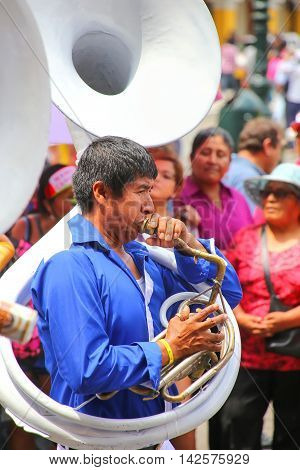 Lima, Peru-january 31: Unidentified Man Plays Sausaphone During Festival Of The Virgin De La Candela