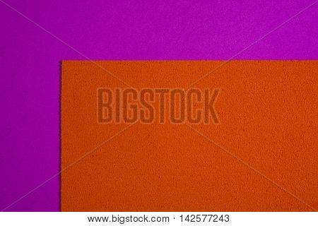 Eva foam ethylene vinyl acetate sponge plush orange surface on pink smooth background