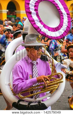 LIMA PERU-FEBRUARY 1: Unidentified man plays sousaphone during Festival of the Virgin de la Candelaria on February 12015 in Lima Peru. Core of the festival is dancing performed by dance schools