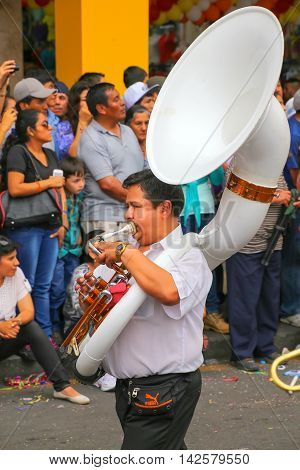 LIMA PERU-FEBRUARY 1: Unidentified man plays sousaphone during Festival of the Virgin de la Candelaria on Februry 12015 in Lima Peru. Core of the festival is dancing performed by different dance schools