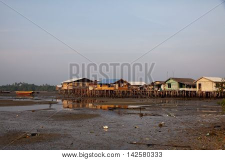 Stilted houses in village on a river on Bintag Island, Indonesia