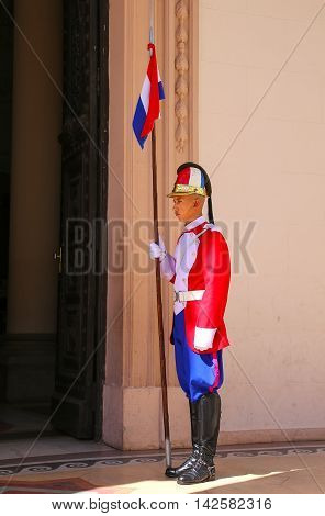 ASUNCION PARAGUAY - DECEMBER 26: Unidentified man guards National Pantheon of the Heroes on December 26 2014 in Asuncion Paraguay. It is mausoleum where lie the remains of great heroes of Paraguay
