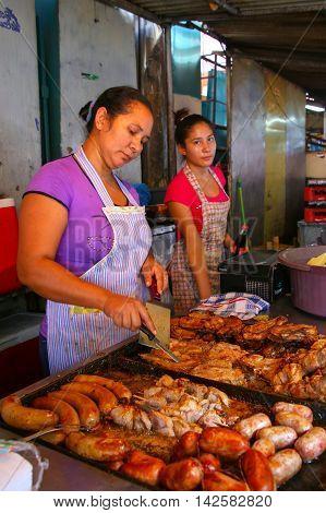Asuncion, Paraguay-december 26: Unidentified Women Cook Meat For Asado December 26, 2014  In Asuncio