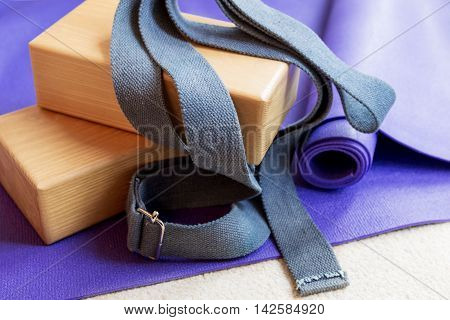 Fitness yoga pilates equipment props on a carpet poster