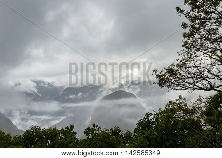 Peaks And Mountains In The Fog