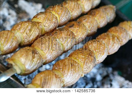Salted and oiled potato prepared on charcoal
