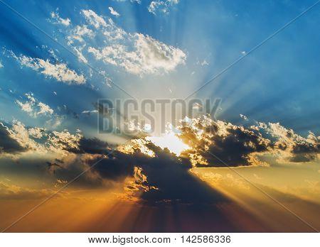 Sunlight breaks through the huge thunderstorm clouds