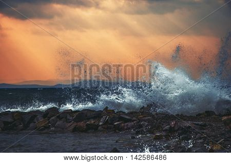 Big wave hit about a shore on the sea coast