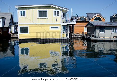Reflections In Float House Village In Victoria -4