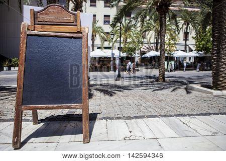 Empty tabloid offering food for terrace restaurants Granada Spain