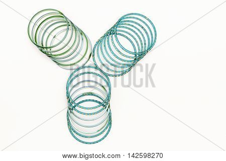 Green and blue Indian bangles on white background