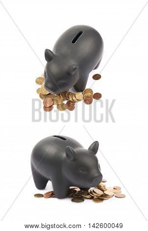 Black ceramic piggy bank coin container next to a pile of euro coins, composition isolated over the white background, set of two different foreshortenings