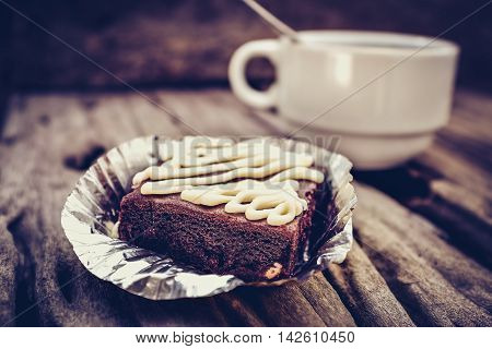 Cake Chocolate Brownie And Hot Coffee On Old Wooden Background. High Contrast And Low Key Light Pict