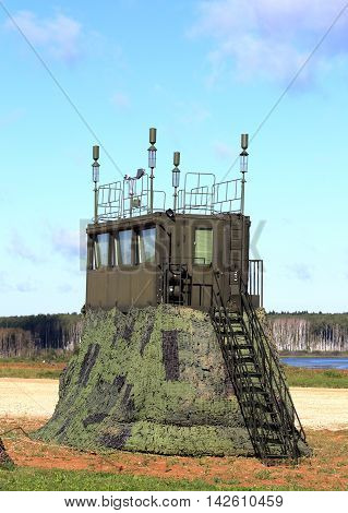 Camouflaged field command communication and observation point with radio communication equipment at the training camp