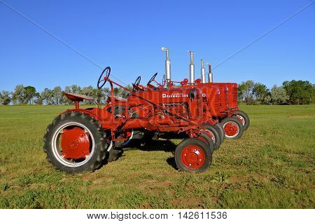 WATFORD CITY, NORTH DAKOTA, June 24, 2016: The red Cub and other tractors bear the Farmall Brand and were manufactured  by the American company know as International Harvester Co.