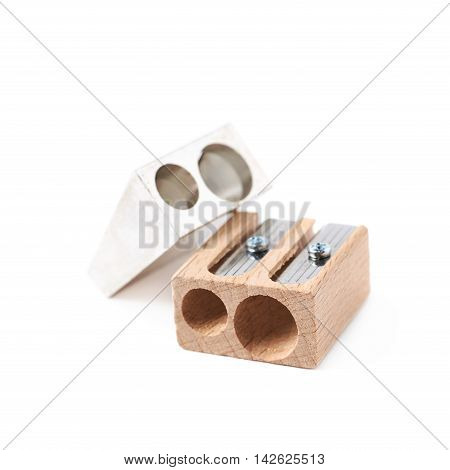 Two, metal and wooden pencil sharpeners, composition isolated over the white background
