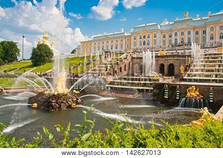 PETERHOF SAINT-PETERSBURG RUSSIA - JUNE 25 2013: Grand Cascade in Peterhof St Petersburg Russia on June 25 2013. Peterhof palace was included in the UNESCO World Heritage List