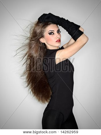Young Beautiful Woman In Black Combi Dress And Velvet Gloves Holding Her Hairs, Ring Flash Studio Po