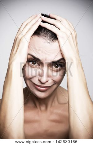 Portrait human emotion facial expression reaction attitude, frustrated angry woman     isolated on grey wall background.