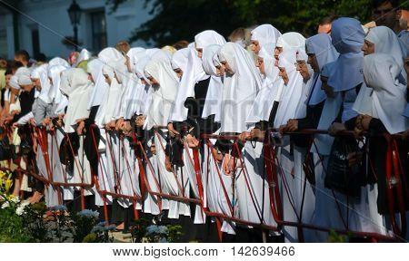 Kiev Ukraine celebration liturgy in honor of the baptism of Rus in Kiev Pechersk Lavra - 27 July 2013 -: Sisters of Mercy standing near the fence head bowed