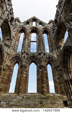 WHITBY ENGLAND - AUGUST 12: The East end section of the ruins of Whitby Abbey. In Whitby North Yorkshire England. On 12th August 2016