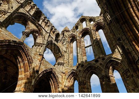 WHITBY ENGLAND - AUGUST 12: section of the ruins of Whitby Abbey. In Whitby North Yorkshire England. On 12th August 2016