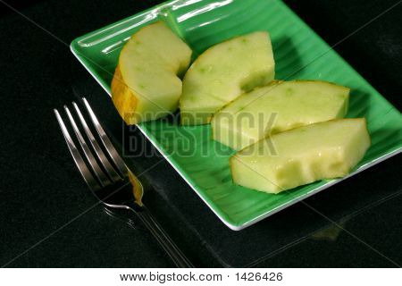 cantaloup (cassaba melon) on the green dish with fork poster