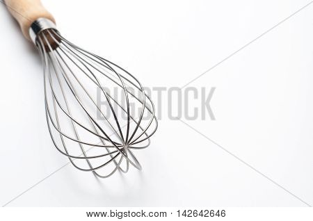 Balloon Whisk Manual Hand Egg Beater on white background.