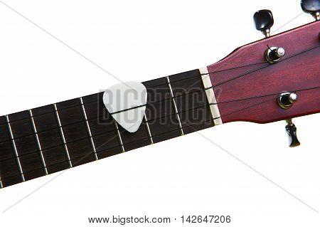 White pick with ukulele fingerboard, isolated on white background