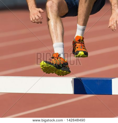 Steeplechase competitor on cross fit competition outdoors