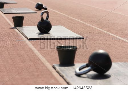 Kettle Bells And Chalk Buckets On Crossfit Competition
