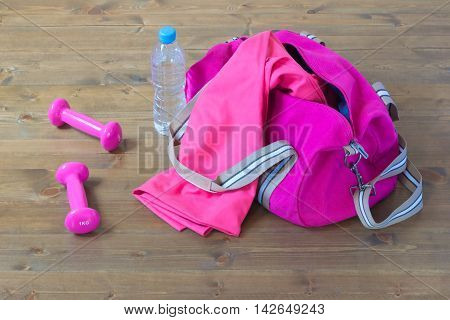 sports equipment out of the bag, on a wooden background floor