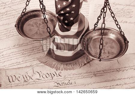 Scales of justice American flag and US Constitution