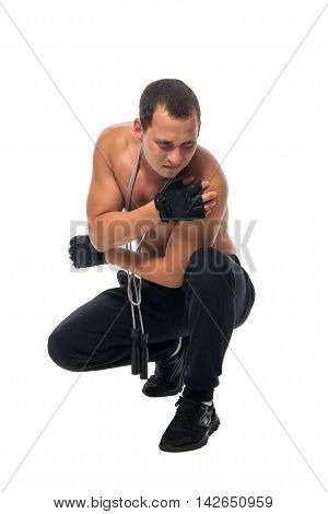 athlete crouched down due to shoulder pain