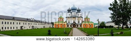 Panorama of Tikhvin assumption male monastery, it is Tikhvin icon of mother of God. The Orthodox Church of Russia. The temple on the banks of the Tikhvinka river in Tikhvin.
