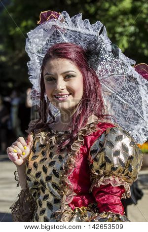 CAGLIARI, ITALY - May 29, 2016: Sunday at La Grande Jatte VIII Ed. At the Public Gardens - Sardinia - portrait of a beautiful smiling girl in Victorian costumes
