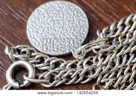 empty pendant on a silver chain macro