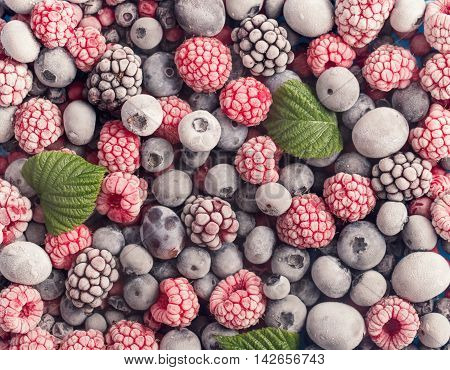 Assorted frozen berries top view. Food background concept