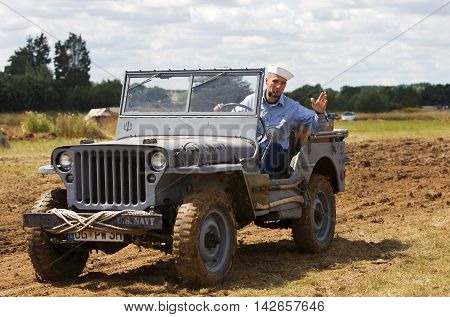 WESTERNHANGER, UK - JULY 25: A WW2 period USN reenactor and jeep parade around the main show arena for the public to watch at the War & Peace show on July 25, 2015 in Westernhanger