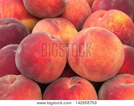 Fresh organic peaches at a farmers market