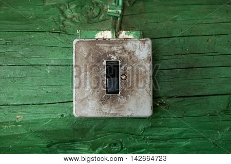 Old Dirty Switch On Wooden Wall