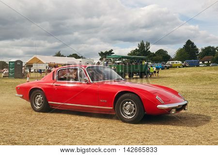 POTTEN END, UK - JULY 27: A classic Lotus Elan sportscar leaves the main display arena having just completed its show to the public at the Dacorum Steam fair on July 27, 2014 in Potten End